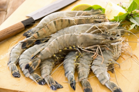 gambas: raw prawns on the wooden board