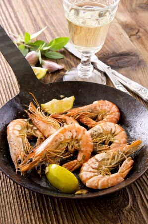 black tiger prawns fried with lemon photo