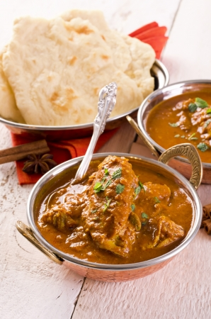 tandoori chicken: indian red chicken curry with naan bread  Stock Photo