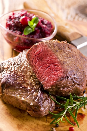 beef steaks with cranberry sauce photo