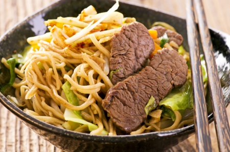 fried noodles with beef slices photo
