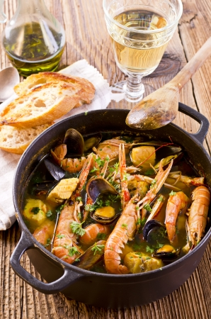 Bouillabaisse soup in the casserole photo