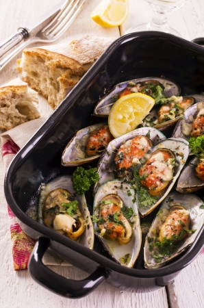 new zeeland mussels baked with herbs photo
