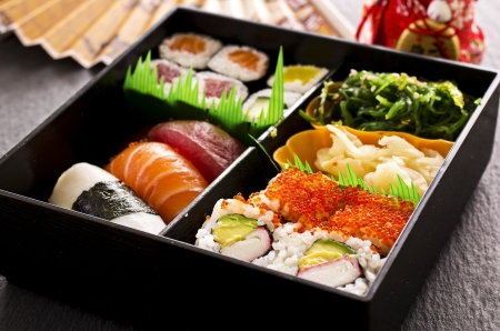 bento box: bento box filled with sushi and rolls Stock Photo