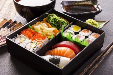 bento box with suhis and rolls photo
