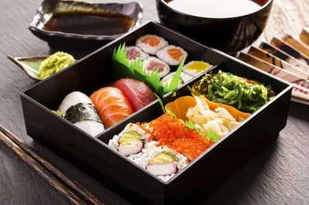 sushi and rolls in bento box photo