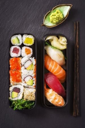 bento box with sushi and rolls