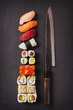 california roll: japanese knife with sushi