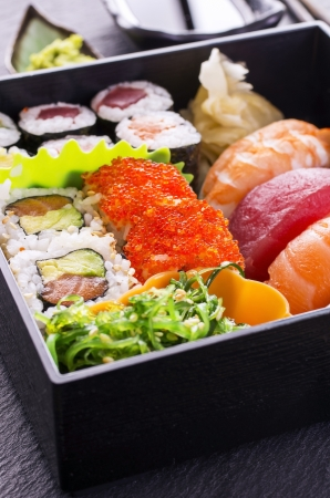 bento: sushi and rolls in bento box