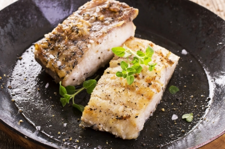cooked fish: grouper fillet fried in the pan Stock Photo