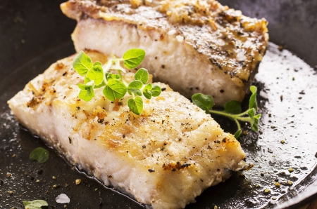 grouper fillet fried with herbs Standard-Bild