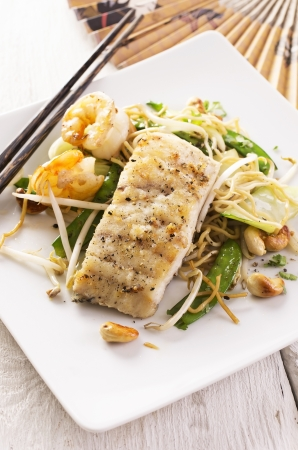 fish fried with noodles and vegetable photo