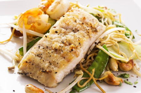 cooked fish: fish with noodles and vegetable Stock Photo