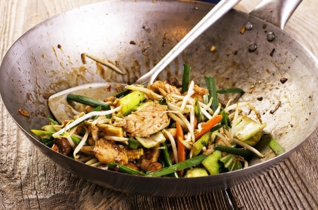 chicken with vegetable stir-fried in wok photo