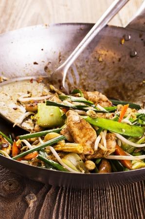 hoisin sauce: stir fried vegetables and chicken in wok