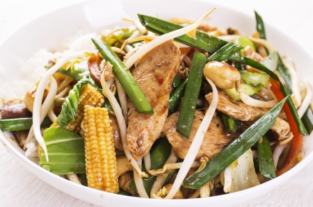 hoisin: chicken with vegetables fried in wok