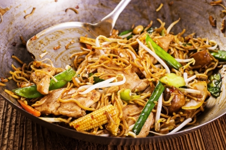 china cuisine: stir fried noodles in wok