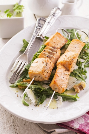 grilled salmon skew with rocket salad Stock Photo - 20360133