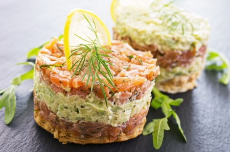 tatar with salmon and avocado photo