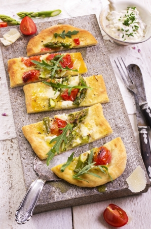 tarte flambee with mozzarella and tomato photo