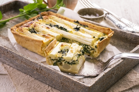 french cuisine: quiche with asparagus and spinach Stock Photo