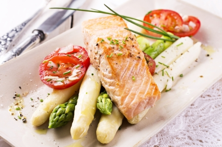cooked fish: asparagus with salmon Stock Photo