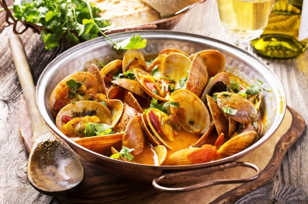 portuguese: venus clams in tomato sauce Stock Photo