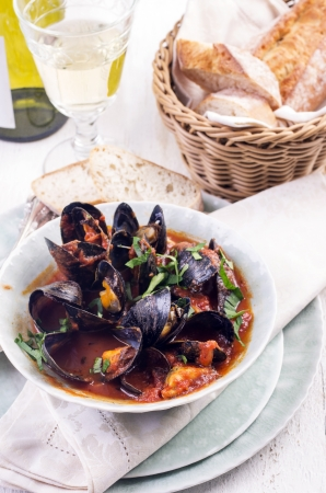 mussels in tomato sauce Imagens
