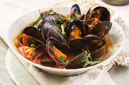 mussels in tomato sauce Stock Photo