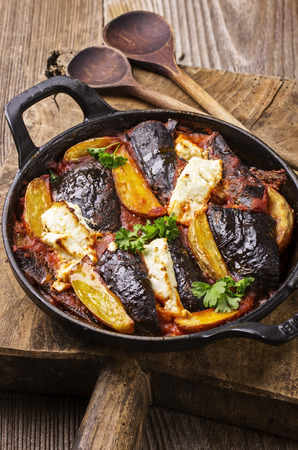 baked eggplant with potato and feta photo