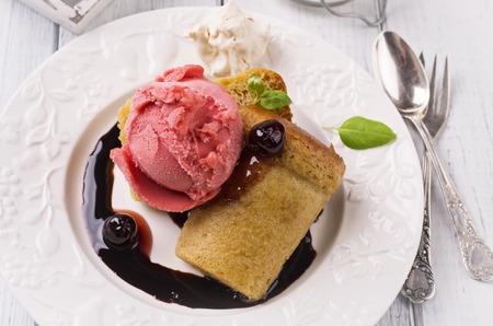 rhum: baba au rhum with ice cream Stock Photo