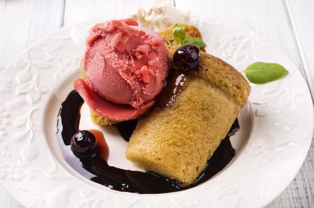 baba au rhum with ice cream Stock Photo