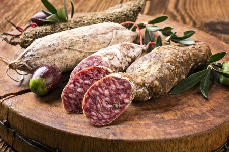 air dried salami: salami on the wooden board