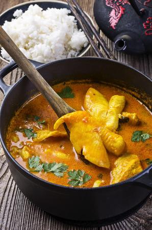 red palm oil: di pesce al curry Archivio Fotografico