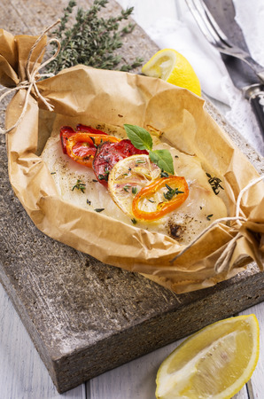 grates: fish baked with vegetables Stock Photo