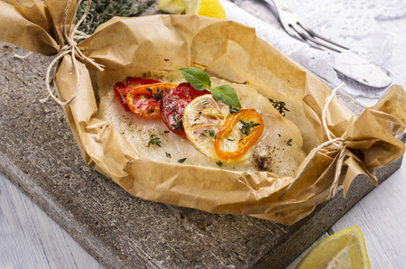 fish baked with vegetables photo