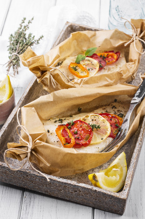 grates: baked fish with vegetables