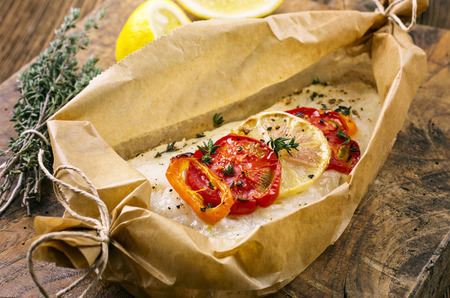fish oven baked with vegetables photo