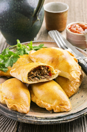 baked meat: pastry with meat empanadas Stock Photo