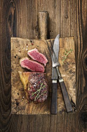 steak plate: steak on the cutting board