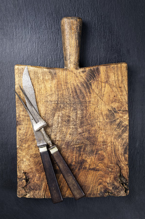 knotty: antique chopping board with knives