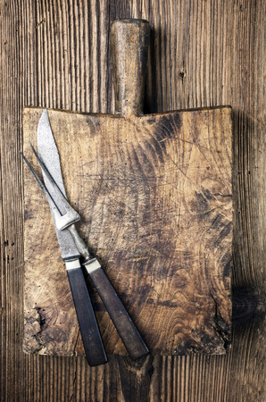 effloresce: antique chopping board with knives