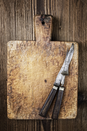 effloresce: antique french cutting board with knives