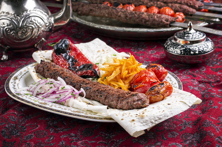 grilled adana kebab with vegetables Stock Photo