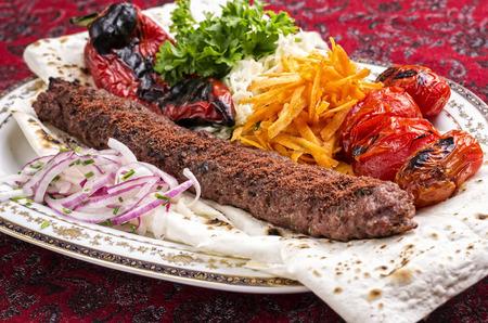 adana kebab with salad and flat bread photo