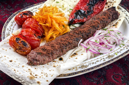 grilled lamb koobideh with vegetables photo