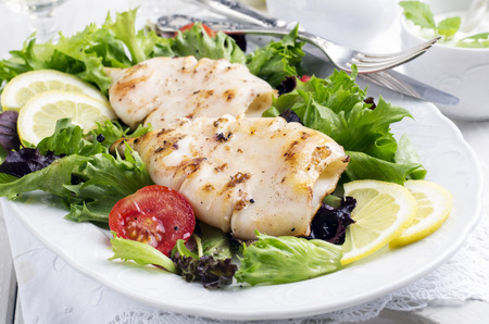 sea food: grilled squid with salad Stock Photo