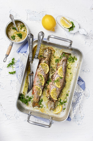 salmo trutta: roasted trout with lemon and herbs Stock Photo
