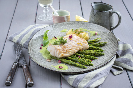 romatic: cod fish fillet with green asparagus Stock Photo