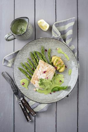 fish fillet: coal fish fillet with green asparagus
